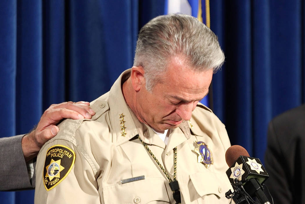Clark County Sheriff Joe Lombardo gets emotional while he talks about two officers during a news conference at the Metropolitan Police Department in Las Vegas, Friday, Oct. 13, 2017. The officers, ...