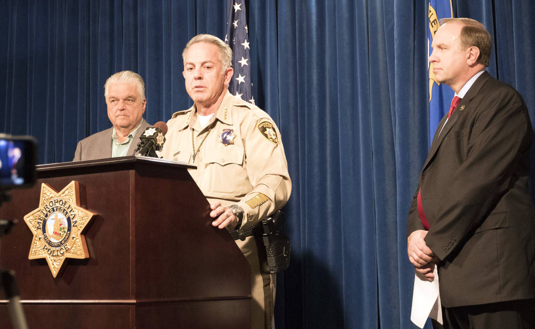 Clark Country Commission Chairman Steve Sisolak, left, Sheriff Joe Lombardo, center, and FBI special agent Aaron Rouse at a news briefing at the Metropolitan Police Department in Las Vegas, Friday ...