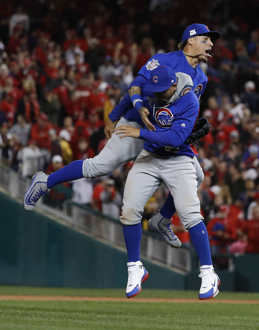 Chicago Cubs Javier Baez and Jon Jay celebrate after beating the Washington Nationals 9-8 to to win baseball's National League Division Series, at Nationals Park, early Friday, Oct. 13, 2017, in W ...