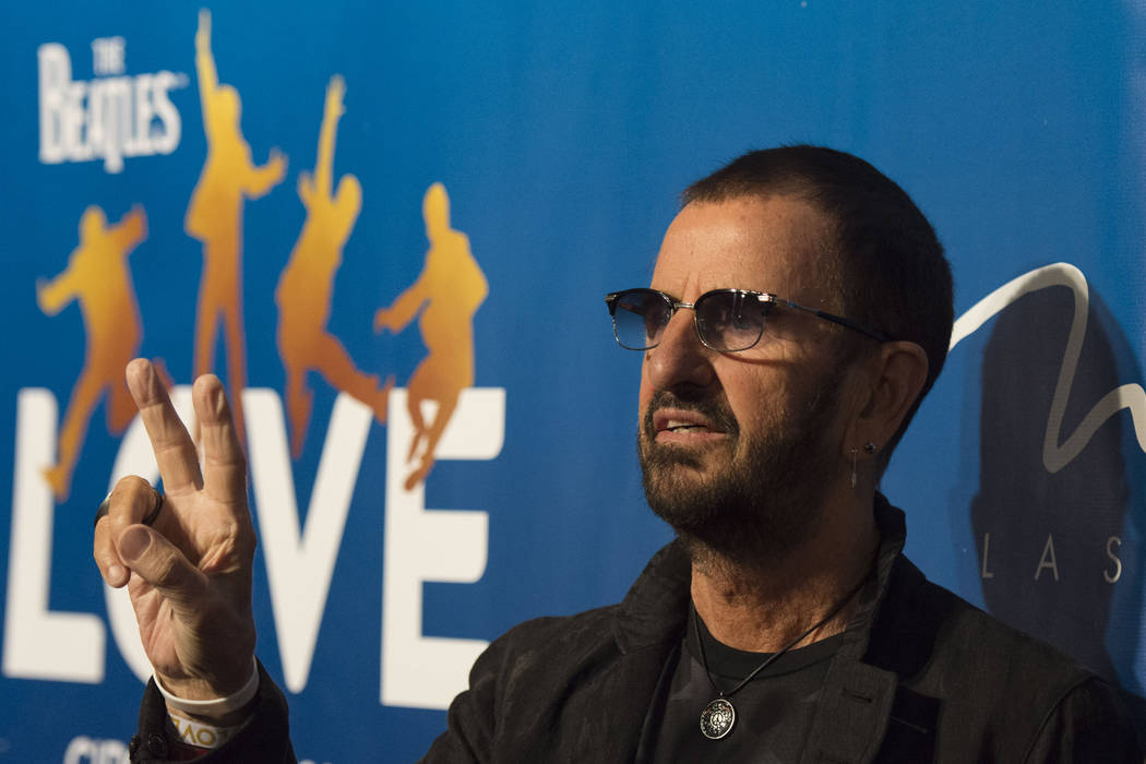 """Beatles drummer Ringo Starr poses during a red carpet event to celebrate the 10th anniversary of Cirque du Soleil's The Beatles """"Love"""" at The Mirage on July 14, 2016. He and his band will be perfo ..."""