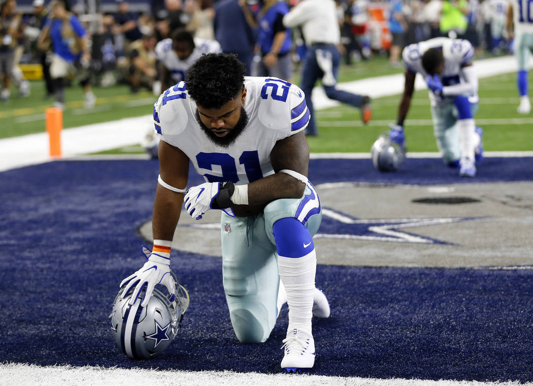 Dallas Cowboys running back Ezekiel Elliott (21) kneels in prayer in the end zone before a Sept. 10 NFL football game against the New York Giants in Arlington, Texas. A federal appeals court on Th ...