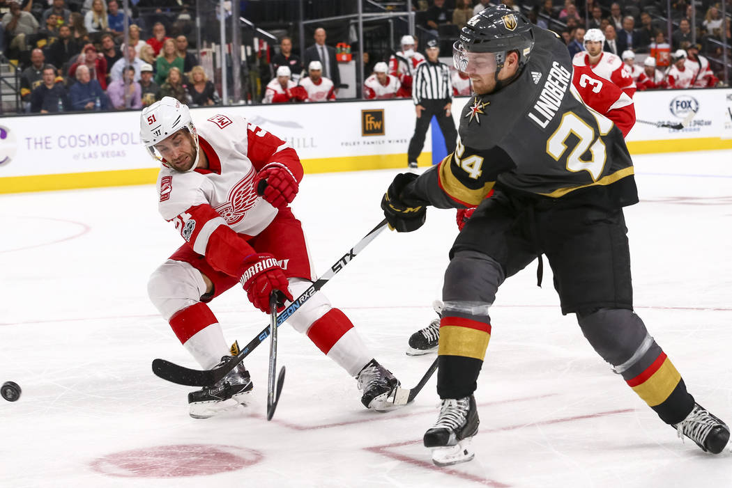Vegas Golden Knights center Oscar Lindberg (24) takes a shot past Detroit  Red Wings cd5193dbc