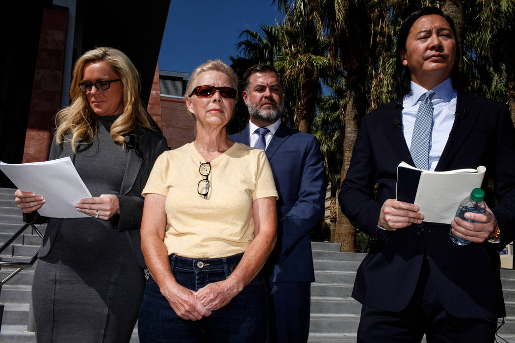 Attorney Christian M. Morris, left, Cheryl Sheppard, mother of Rachel Sheppard, second from left, attorney Brian D. Nettles, second from right, and lead attorney James Lee, right, gather in front  ...