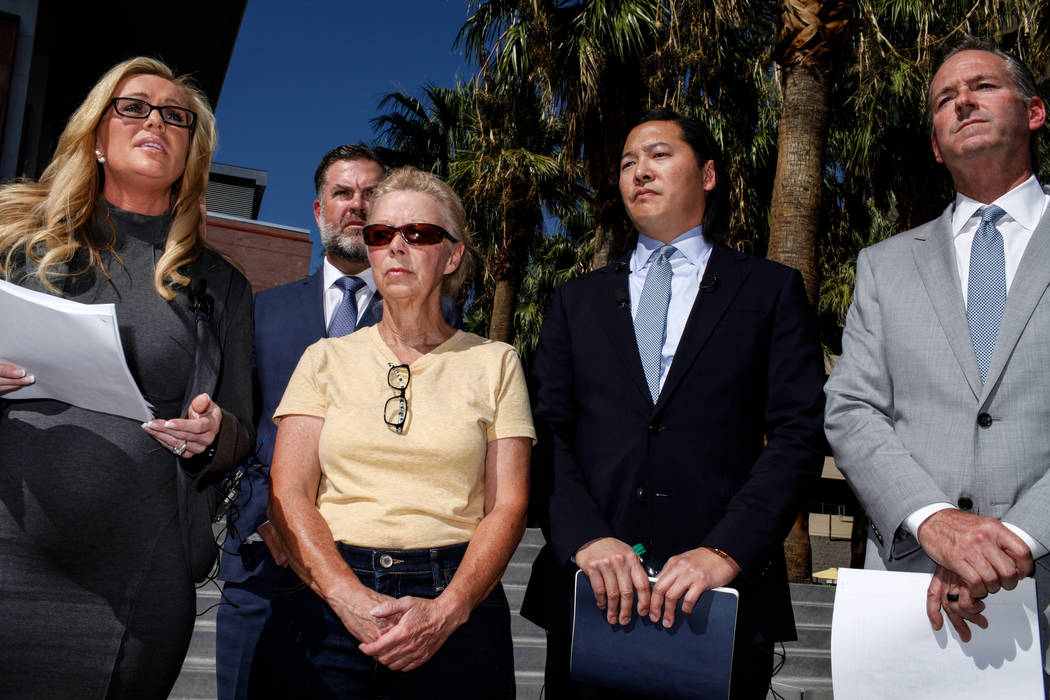 Attorney Christian M. Morris, left, attorney Brian D. Nettles, second from left, Cheryl Sheppard, mother of Rachel Sheppard, center, lead attorney James Lee, second from right, and attorney Craig  ...