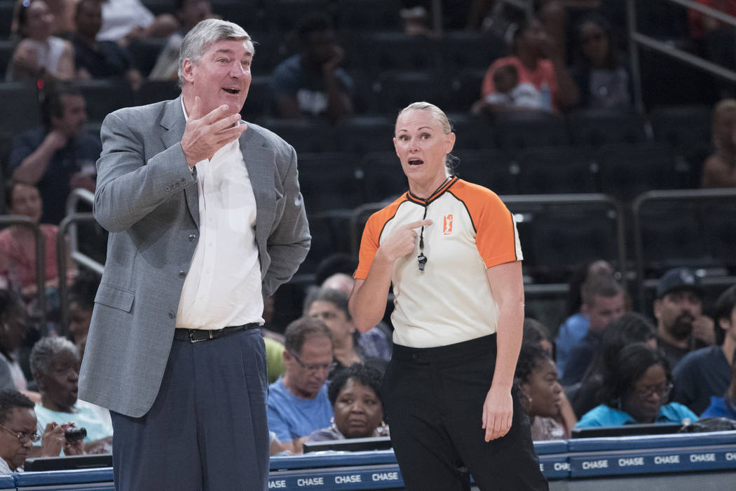 New York Liberty head coach Bill Laimbeer, left, argues with a referee during the first half of a WNBA basketball game against the Connecticut Sun, Wednesday, July 19, 2017 at Madison Square Garde ...
