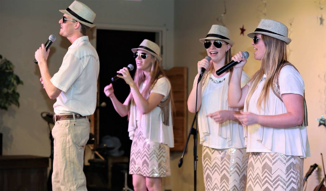 The four Jackson children: (from left to right) Grayden, Mickinzie, Skyler and Tess perform on stage together during a Mama's Wranglers show in February of this year. The group owns and performs i ...