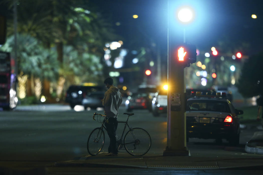 A man takes in the scene outside of the Route 91 festival grounds during the early hours of Monday, Oct. 2, 2017, following an active-shooter situation on the Las Vegas Strip. Chase Stevens Las Ve ...