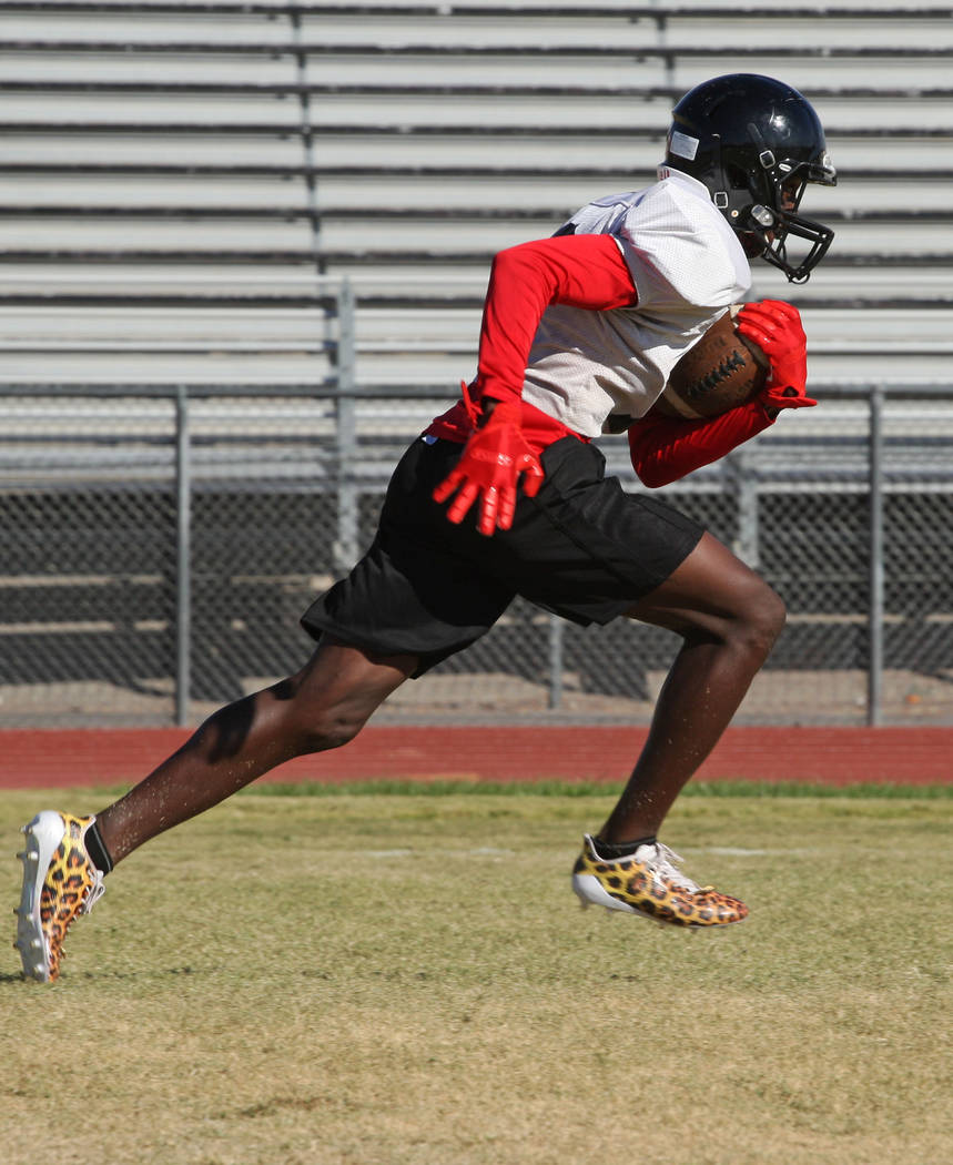 a7a8f0109267 Wide receiver Miles Davis drives the ball down the field during the  Wildcats s football practice at