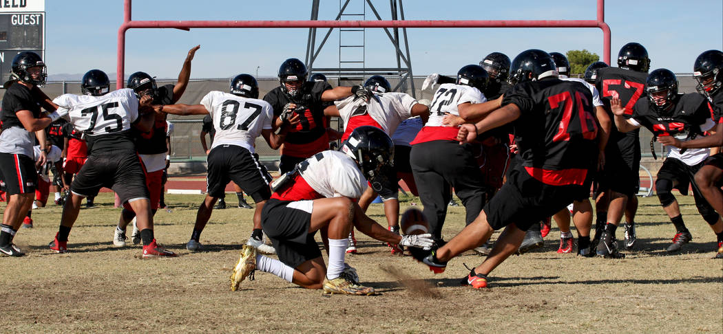 69be48081acd Kicker Brian Batres (76) practices an extra point kick during the  Wildcats s football practice