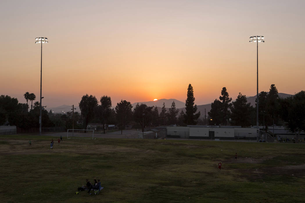 The sun sets over Riverside seen from Richard Rollins Community Park in Grand Terrace, California on Thursday, Oct. 12, 2017. Bridget Bennett Las Vegas Review-Journal @BridgetKBennett