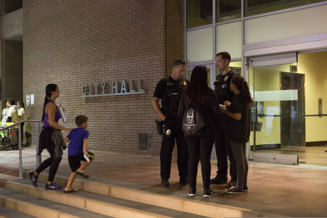 Officers patrol outside Riverside City Hall while thousands of patrons made their way to downtown Riverside, California for Long Night of Arts & Innovation on Thursday, Oct. 12, 2017. Long Nig ...
