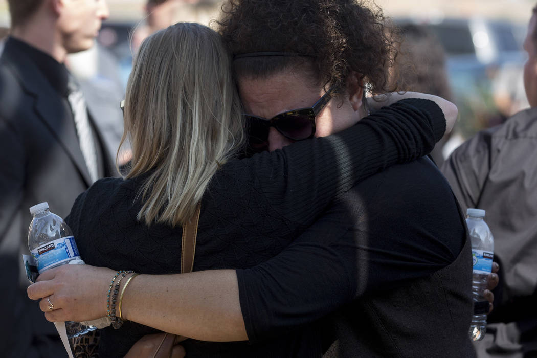 Family and friends embrace after the funeral for Hannah Ahlers, 34, from Beaumont, California at Harvest Christian Fellowship in Riverside, California on Friday, Oct. 13, 2017. Bridget Bennett Las ...