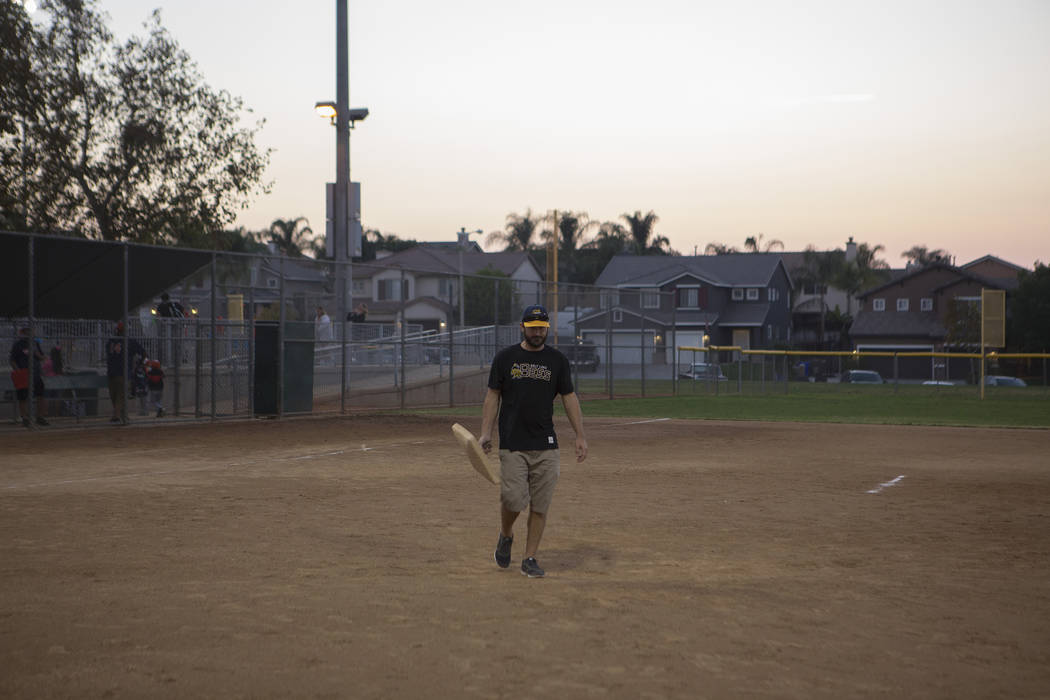 Dylan Bertino helps clear the field after his son's baseball game at Orange Terrace Community Park in Riverside, California on Friday, Oct. 13, 2017. Bertino was at Route 91 on Oct. 1 when a man o ...