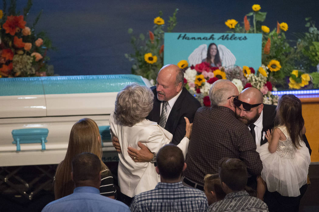 Family and friends embrace prior to the funeral of Hannah Ahlers, 34, from Beaumont, California, at Harvest Christian Fellowship in Riverside, California on Friday, Oct. 13, 2017. Ahlers was one o ...