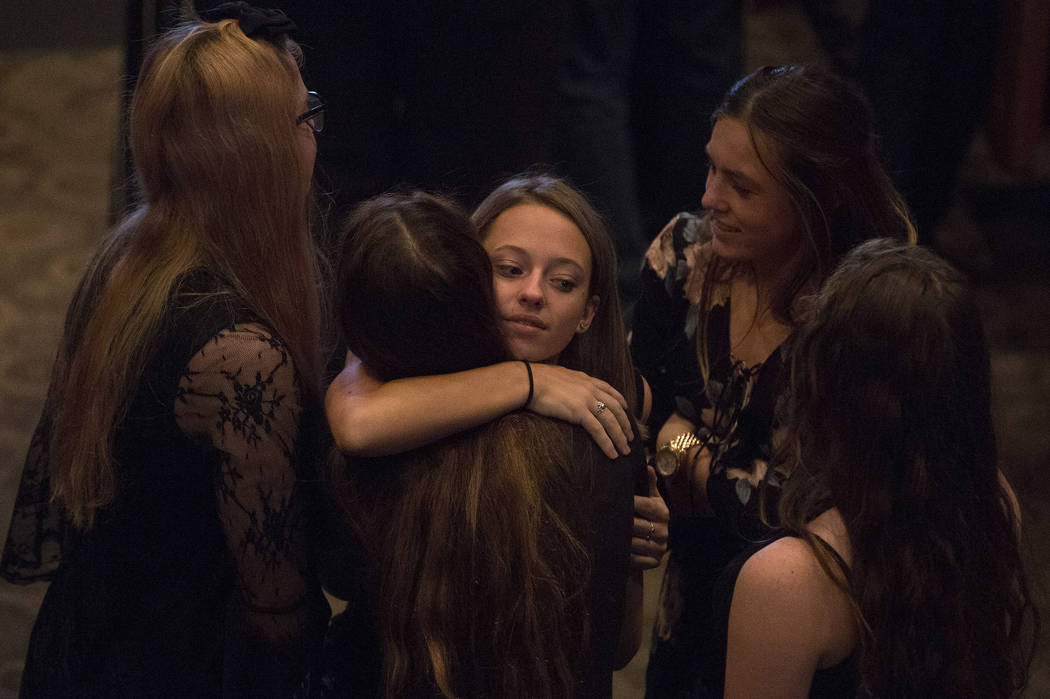 Prior to the funeral of Hannah Ahlers, 34, family and friends embrace including Ahlers's daughter Briannah, 14, in upper right, at Harvest Christian Fellowship in Riverside, California on Friday,  ...