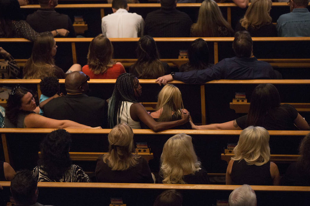 Family and friends embrace prior tor the funeral of Hannah Ahlers, 34, from Beaumont, California at Harvest Christian Fellowship in Riverside, Friday, Oct. 13, 2017. Ahlers was one of many victims ...