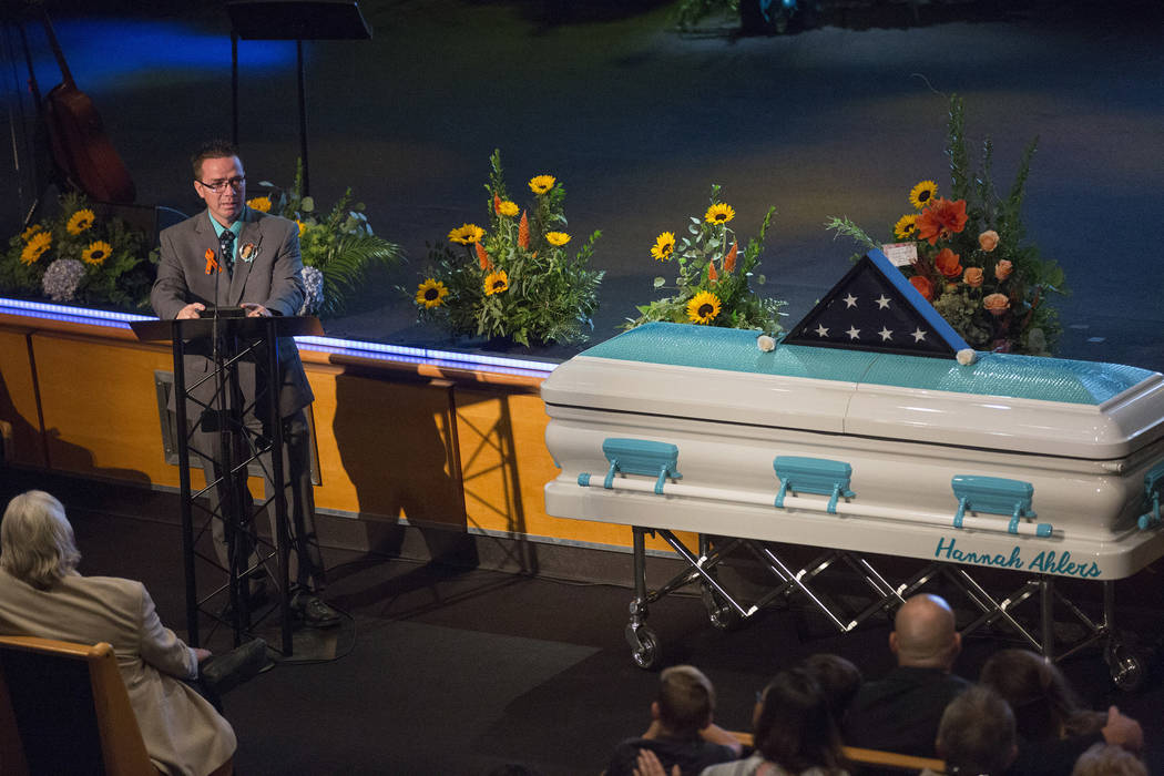 Family friend Chris Hopkins speaks during the funeral of Hannah Ahlers, 34, from Beaumont, California at Harvest Christian Fellowship in Riverside, California on Friday, Oct. 13, 2017. Bridget Ben ...