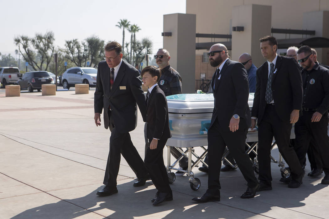Family and friends carry Hannah Ahlers's, 34, casket to a hearse after the funeral at Harvest Christian Fellowship in Riverside, California on Friday, Oct. 13, 2017. Bridget Bennett Las Vegas Revi ...