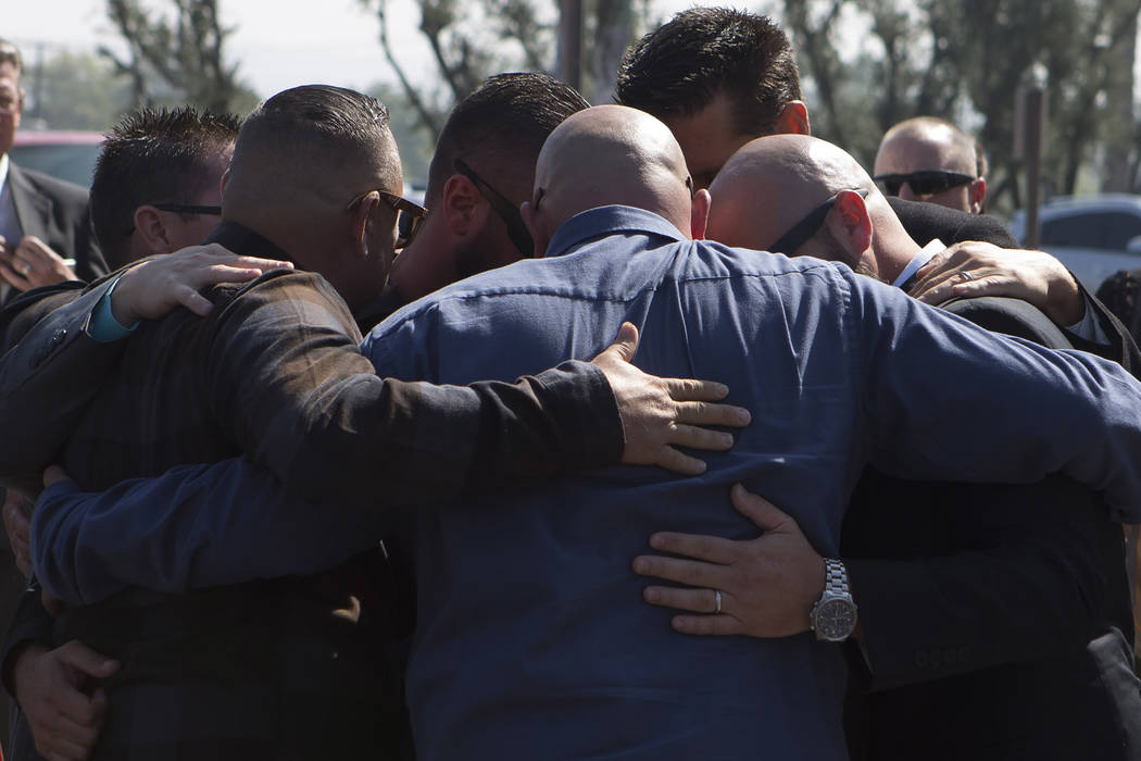 Family and friends embrace after the funeral of Hannah Ahlers, 34, from Beaumont, California at Harvest Christian Fellowship in Riverside, California on Friday, Oct. 13, 2017. Ahlers was one of ma ...