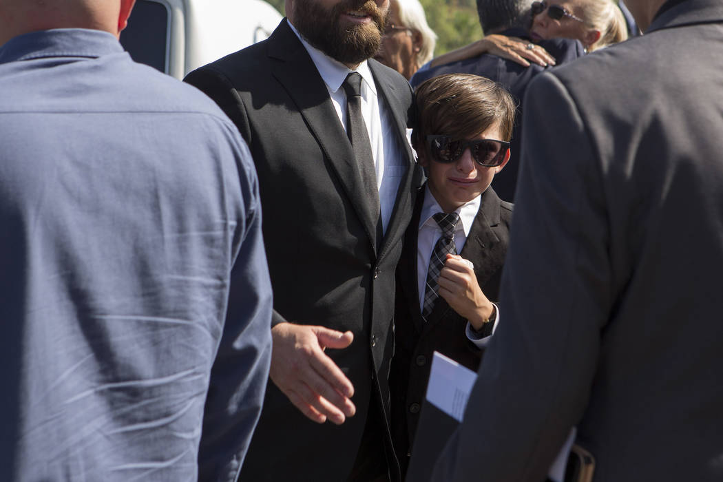 After the funeral of Hannah Ahlers, 34, from Beaumont, California husband Brian Ahlers,left, embraces son Brice, 11,  at Harvest Christian Fellowship in Riverside, California on Friday, Oct. 13, 2 ...