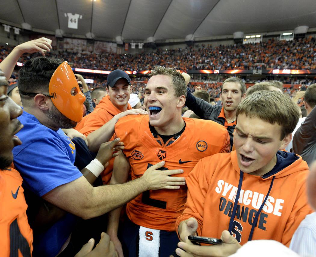 8e457d420 Syracuse quarterback Eric Dungey center