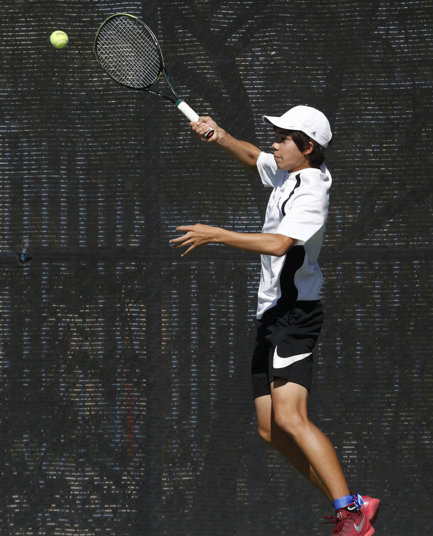 Clark High's doubles player Dustin Mader returns the ball against Palo Verde High during the Class 4A state finals at Darling Tennis Center Friday, Oct. 20, 2017, in Las Vegas. Bizuayehu Tesfaye L ...