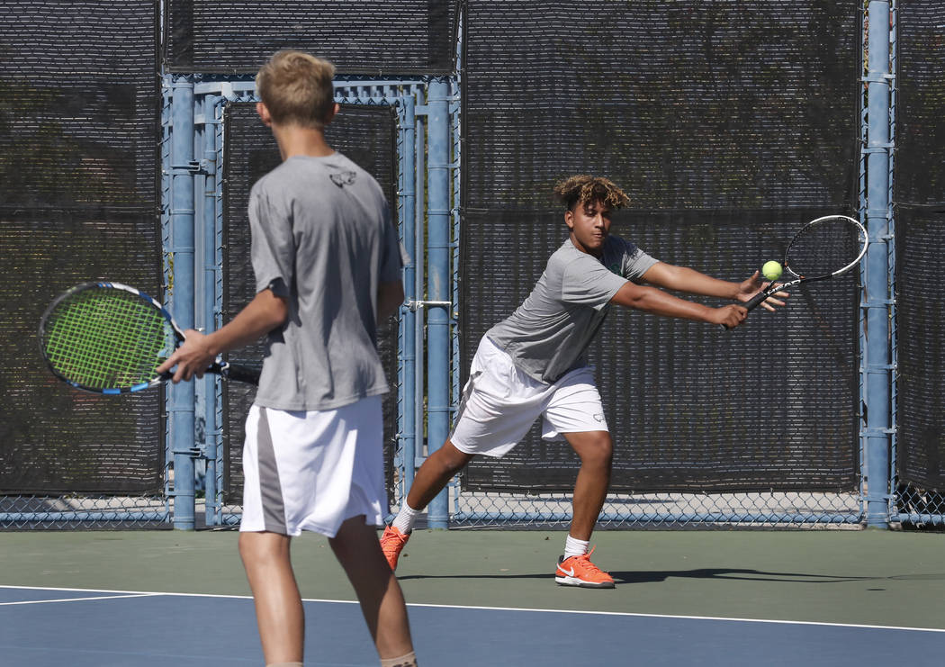 Palo Verde doubles player Hayden Huckfeldt returns the ball against Clark High as his tennis partner Ben Waid looks on during the Class 4A state finals at Darling Tennis Center Friday, Oct. 20, 20 ...