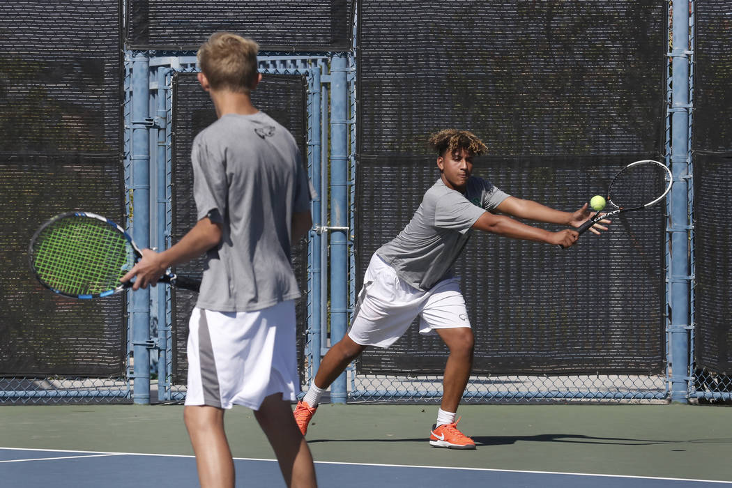 Palo Verde doubles player Hayden Huckfeldt returns the ball against Clark High as his tennis partner Ben Waid looks on during the Class 4A state doubles finals at Darling Tennis Center Friday, Oct ...
