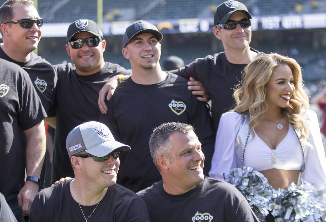 First responders from the Las Vegas shooting meet with a Raiderette before the Oakland Raiders game against the Los Angeles Chargers in Oakland, Calif., Sunday, Oct. 15, 2017. Heidi Fang Las Vegas ...