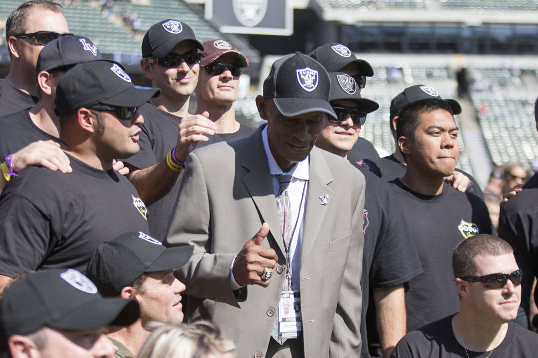 First responders from the Las Vegas shooting meet with former Oakland Raiders cornerback Willie Brown before the game against the Los Angeles Chargers in Oakland, Calif., Sunday, Oct. 15, 2017. He ...