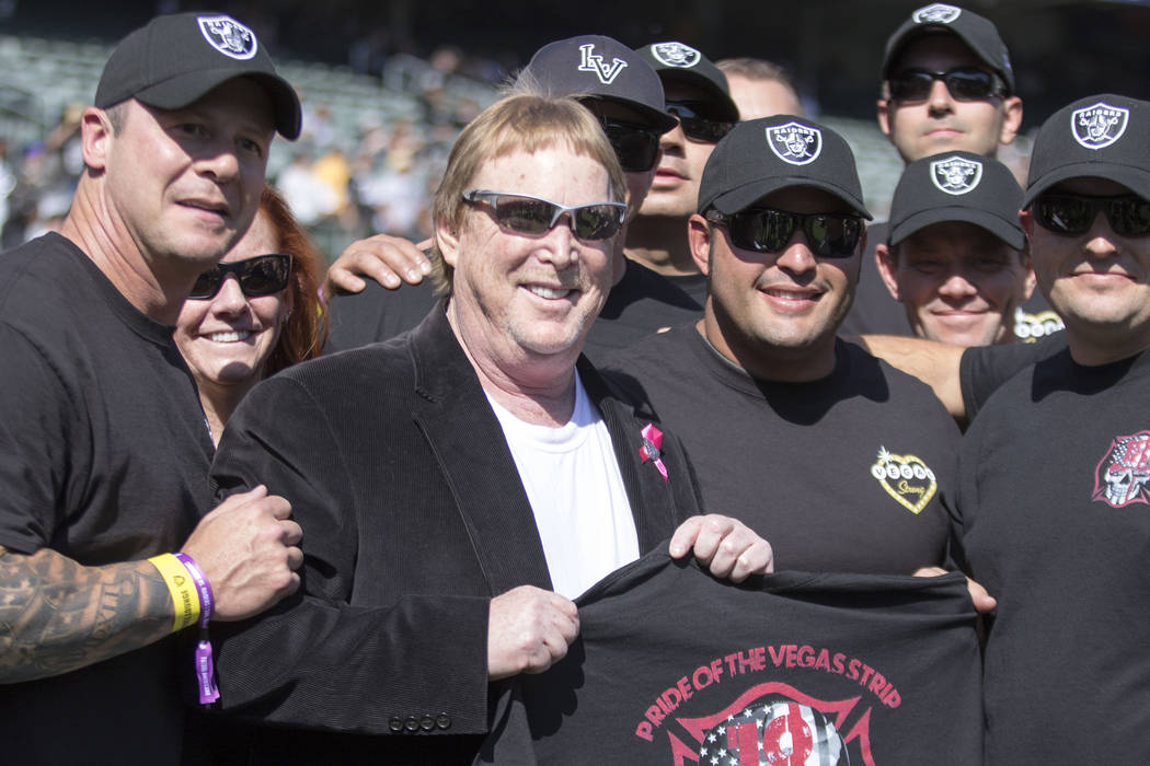 First responders from the Las Vegas shooting meet with Oakland Raiders owner Mark Davis (white shirt) before the game against the Los Angeles Chargers in Oakland, Calif., Sunday, Oct. 15, 2017. He ...