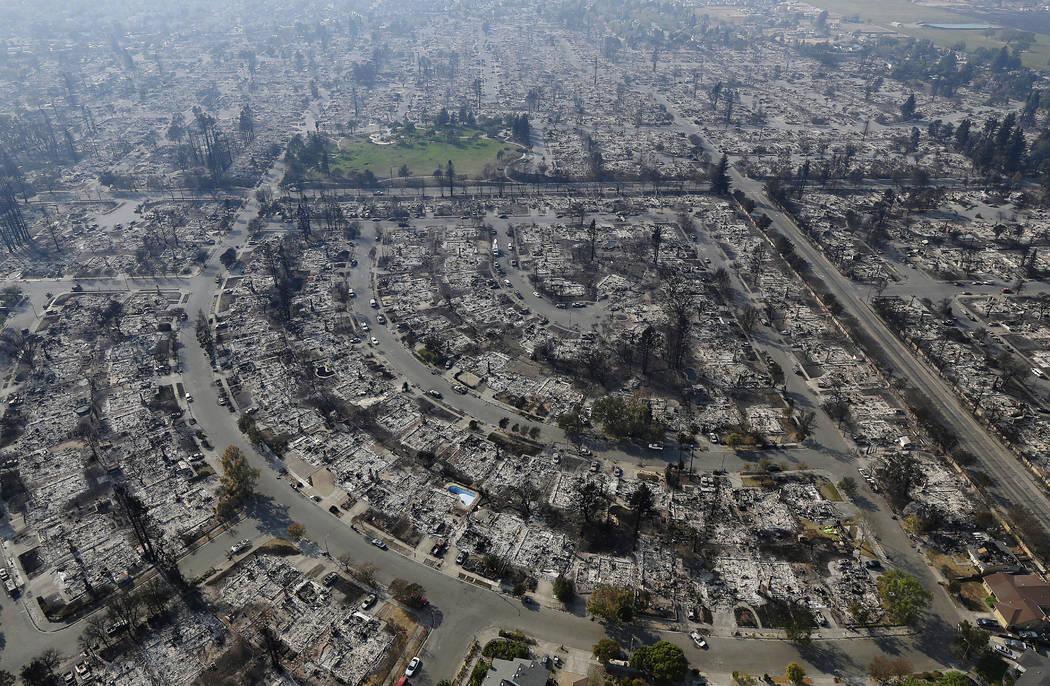 Dozens missing in California wildfires as more evacuees return home