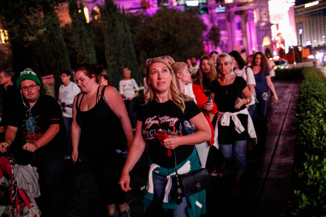 Denise Andrini of Las Vegas, 45, walks along the Strip during the Vegas Strong Las Vegas Strip Walk honoring the victims of the Route 91 Harvest Festival shooting in Las Vegas, Sunday, Oct. 15, 20 ...