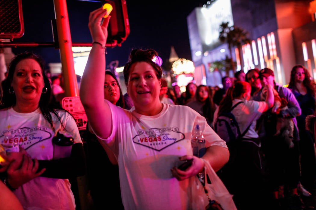 Jennifer Levine of Las Vegas, 37, right, holds a candle as she walks along the Strip during the Vegas Strong Las Vegas Strip Walk honoring the victims of the Route 91 Harvest Festival shooting in  ...