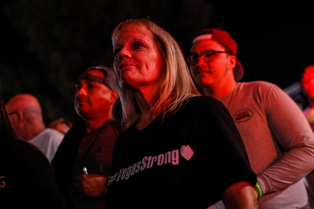 Cindy Padlo of Las Vegas walks along the Strip during the Vegas Strong Las Vegas Strip Walk honoring the victims of the Route 91 Harvest Festival shooting in Las Vegas, Sunday, Oct. 15, 2017. Joel ...