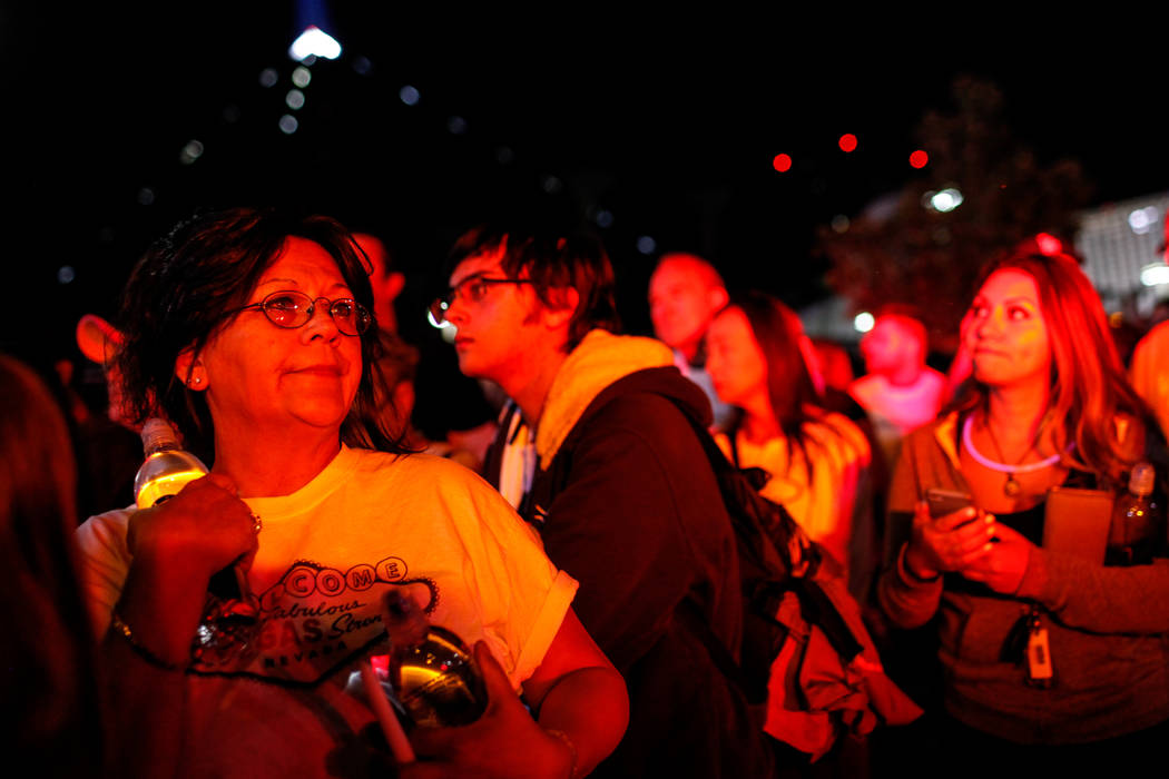 Loraine Ortega of Las Vegas, 56, gathers across Mandalay Bay during the Vegas Strong Las Vegas Strip Walk honoring the victims of the Route 91 Harvest Festival shooting in Las Vegas, Sunday, Oct.  ...