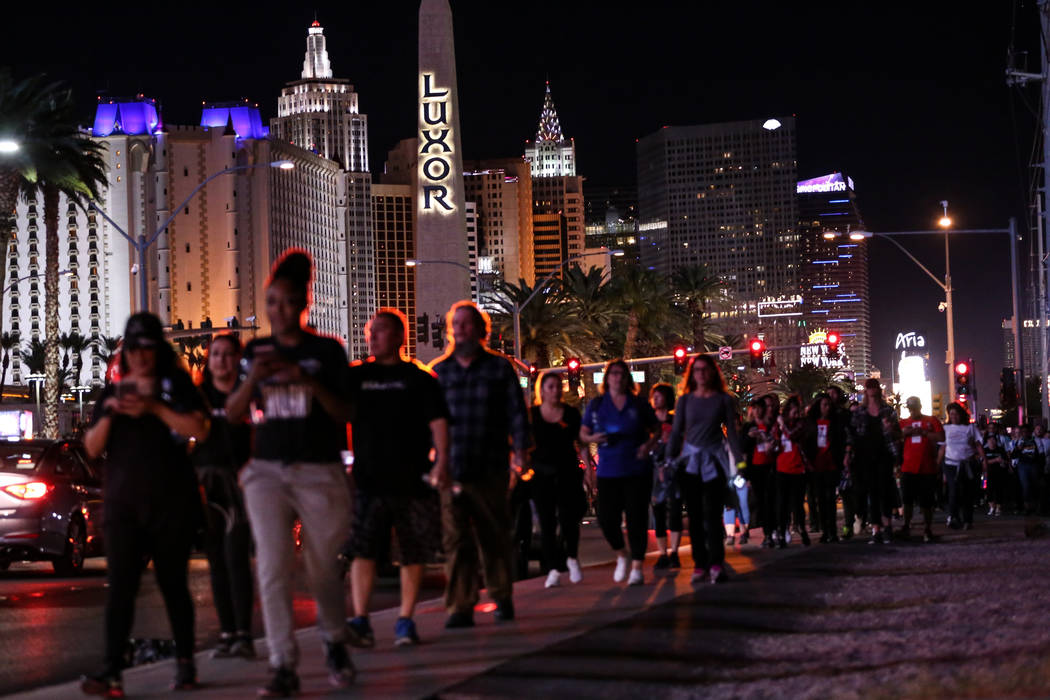 People gather across Mandalay Bay during the Vegas Strong Las Vegas Strip Walk honoring the victims of the Route 91 Harvest Festival shooting in Las Vegas, Sunday, Oct. 15, 2017. Joel Angel Juarez ...