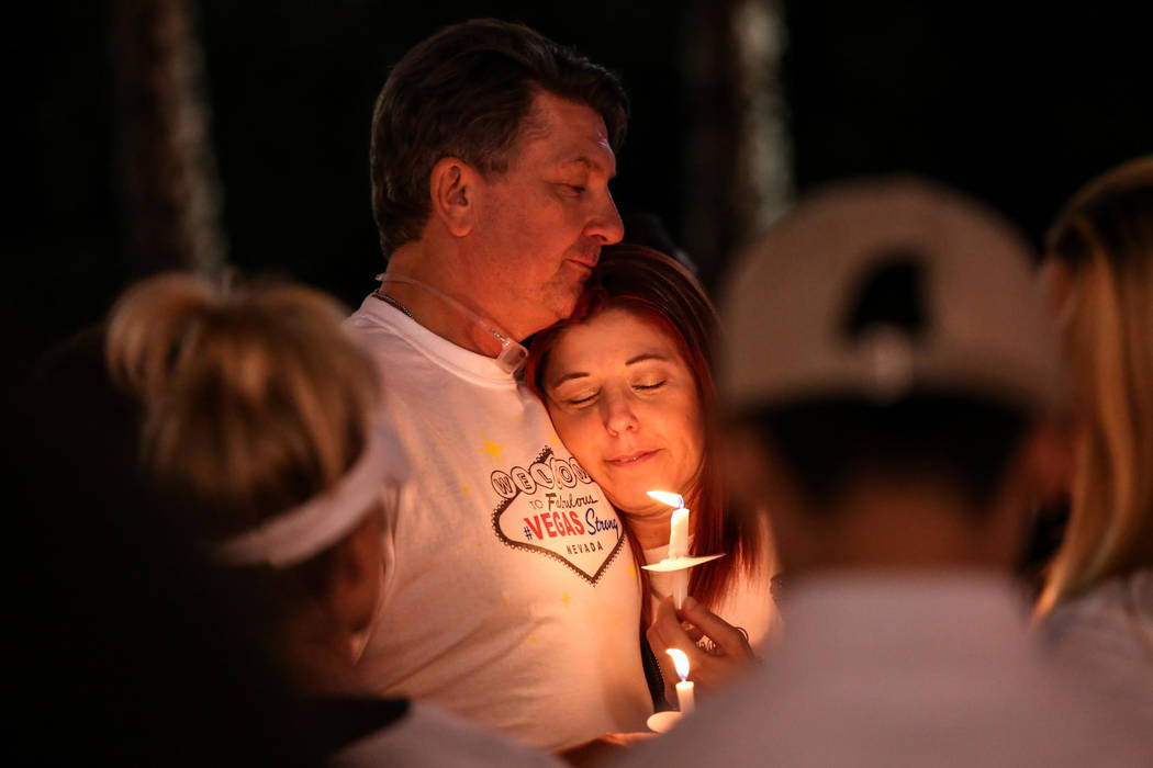 Michael Almeido, 54, and his sister Jennifer Almeido, 46, both of Las Vegas, gather across Mandalay Bay during the Vegas Strong Las Vegas Strip Walk honoring the victims of the Route 91 Harvest Fe ...