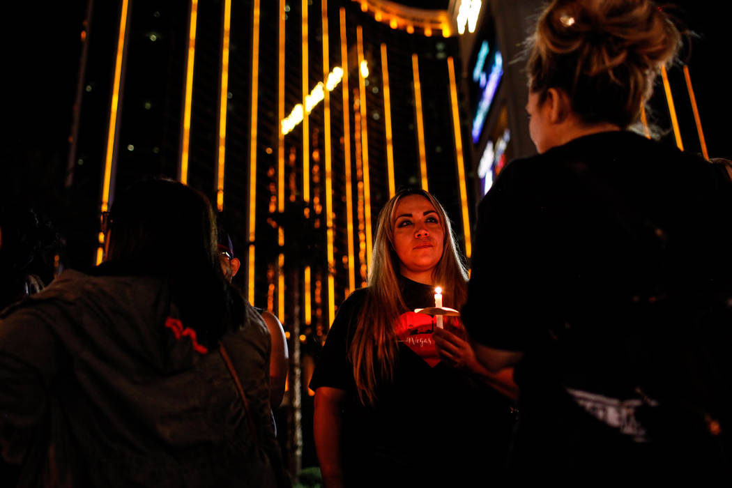 Alma Martinez of Las Vegas, 34, gathers across Mandalay Bay during the Vegas Strong Las Vegas Strip Walk honoring the victims of the Route 91 Harvest Festival shooting in Las Vegas, Sunday, Oct. 1 ...