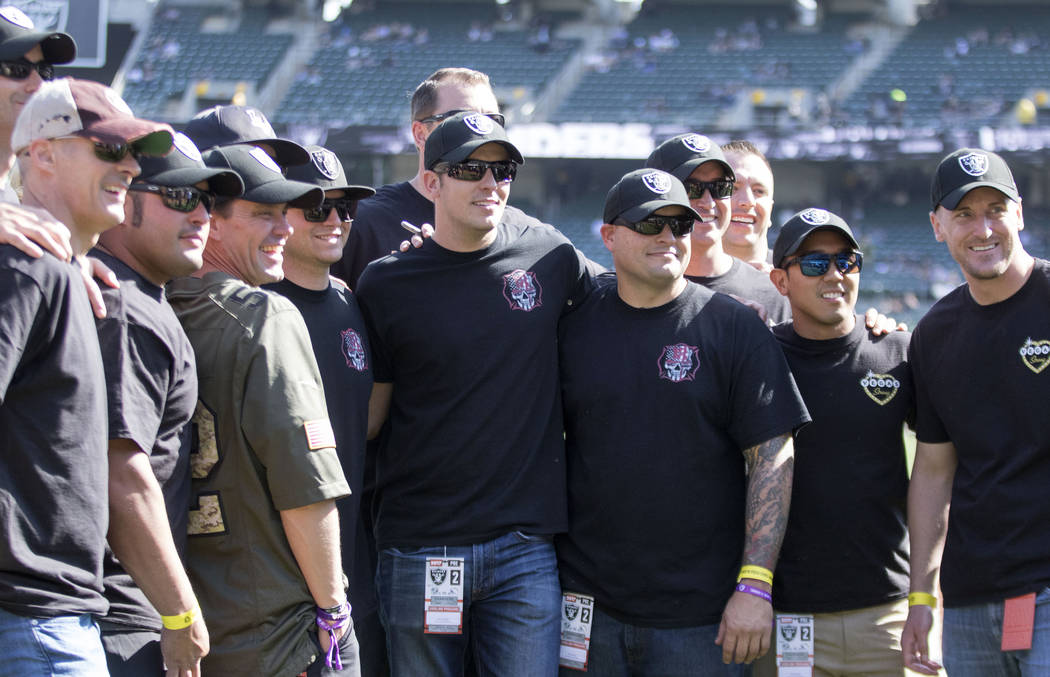 First responders from the Las Vegas shooting have VIP access to the field before the Oakland Raiders game against the Los Angeles Chargers in Oakland, Calif., Sunday, Oct. 15, 2017. Heidi Fang Las ...