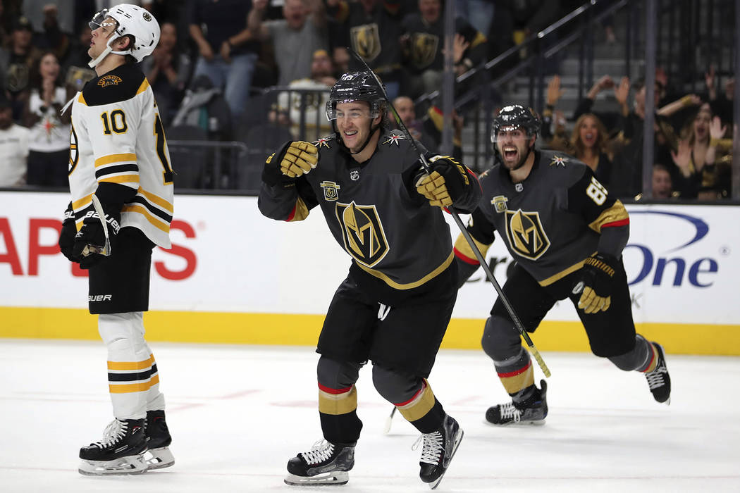 Vegas Golden Knights left wing Brendan Leipsic (13) and Vegas Golden Knights right wing Alex Tuch (89) celebrate a goal over the Boston Bruins during the second period of an NHL hockey game at T-M ...