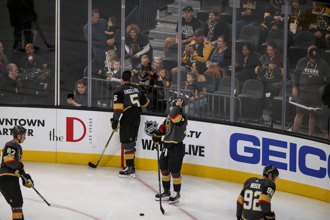 Vegas Golden Knights defenseman Deryk Engelland (5) interacts with fans during a warmup before the start of an NHL hockey game against the Boston Bruins at T-Mobile Arena in Las Vegas, Sunday, Oct ...