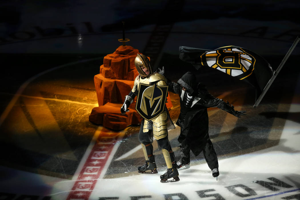 A Vegas Golden Knights mascot, left, and a Boston Bruins mascot, right, appear during a pregame ceremony of an NHL hockey game between the Vegas Golden Knights and the Boston Bruins at T-Mobile Ar ...