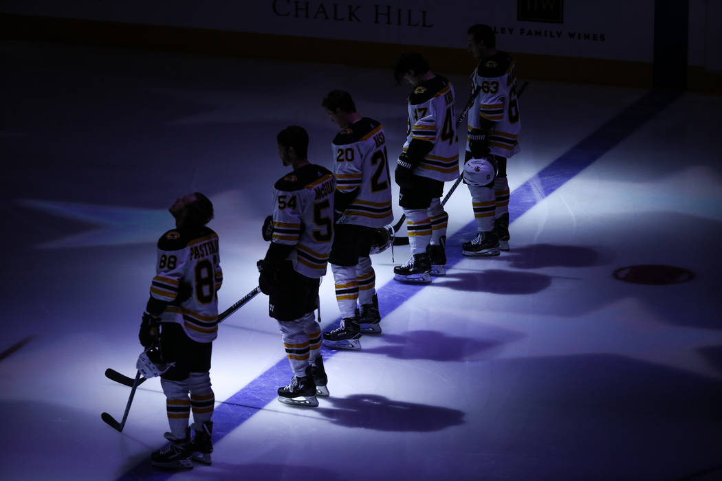 The Boston Bruins appear during a pregame ceremony of an NHL hockey game against the Vegas Golden Knights at T-Mobile Arena in Las Vegas, Sunday, Oct. 15, 2017. Joel Angel Juarez Las Vegas Review- ...