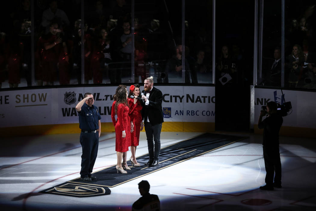 Fire Captain Dave Bray, a first responder of the October 1st mass shooting, left, appears during a pregame ceremony of an NHL hockey game between the Vegas Golden Knights and the Boston Bruins at  ...