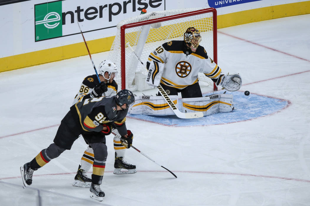 Boston Bruins goalie Tuukka Rask (40), right, blocks a shot from Vegas Golden Knights left wing Tomas Nosek (92), left, during the first period of an NHL hockey game at T-Mobile Arena in Las Vegas ...