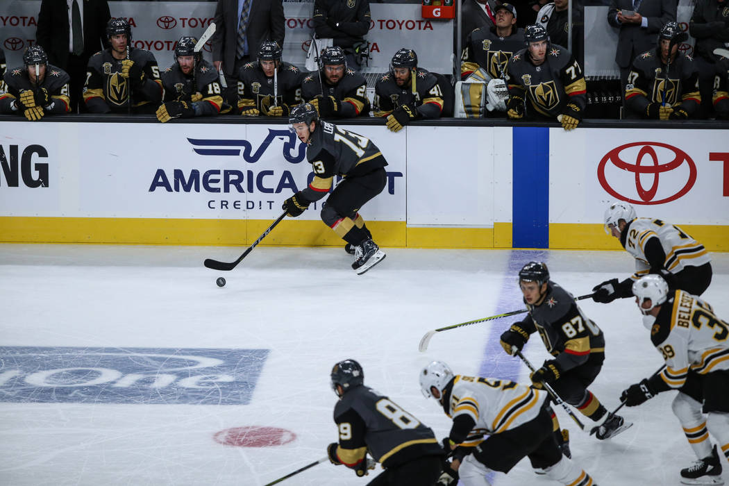 Vegas Golden Knights left wing Brendan Leipsic (13), top, skates past the Boston Bruins during the first period of an NHL hockey game at T-Mobile Arena in Las Vegas, Sunday, Oct. 15, 2017. Joel An ...