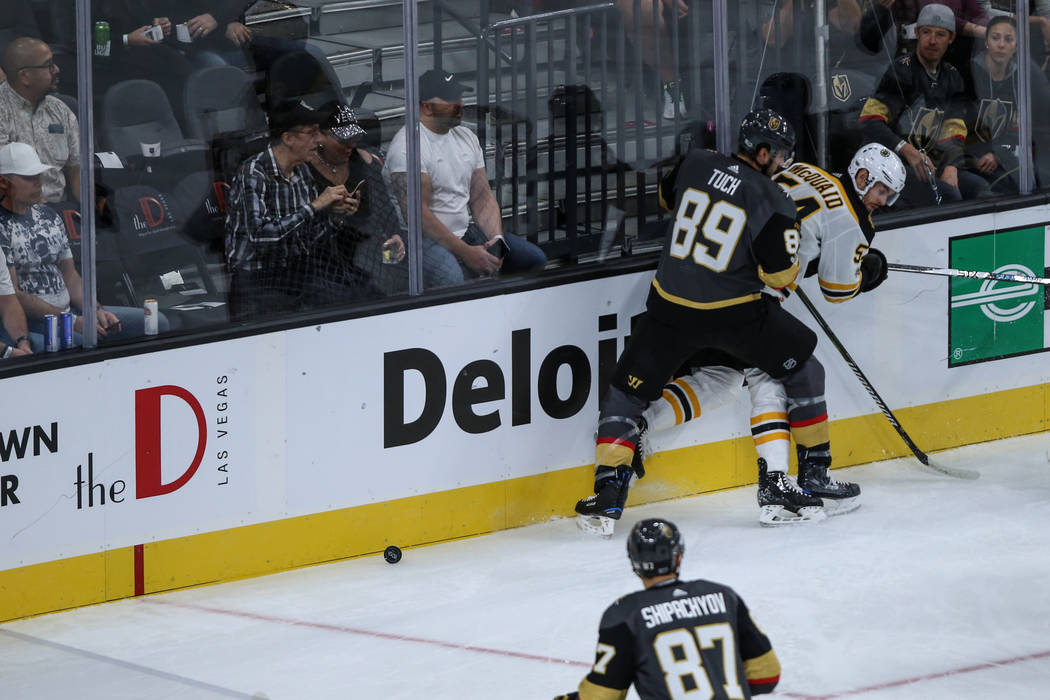 Vegas Golden Knights right wing Alex Tuch (89), left, blocks Boston Bruins defenseman Adam McQuaid (54), right, during the first period of an NHL hockey game at T-Mobile Arena in Las Vegas, Sunday ...