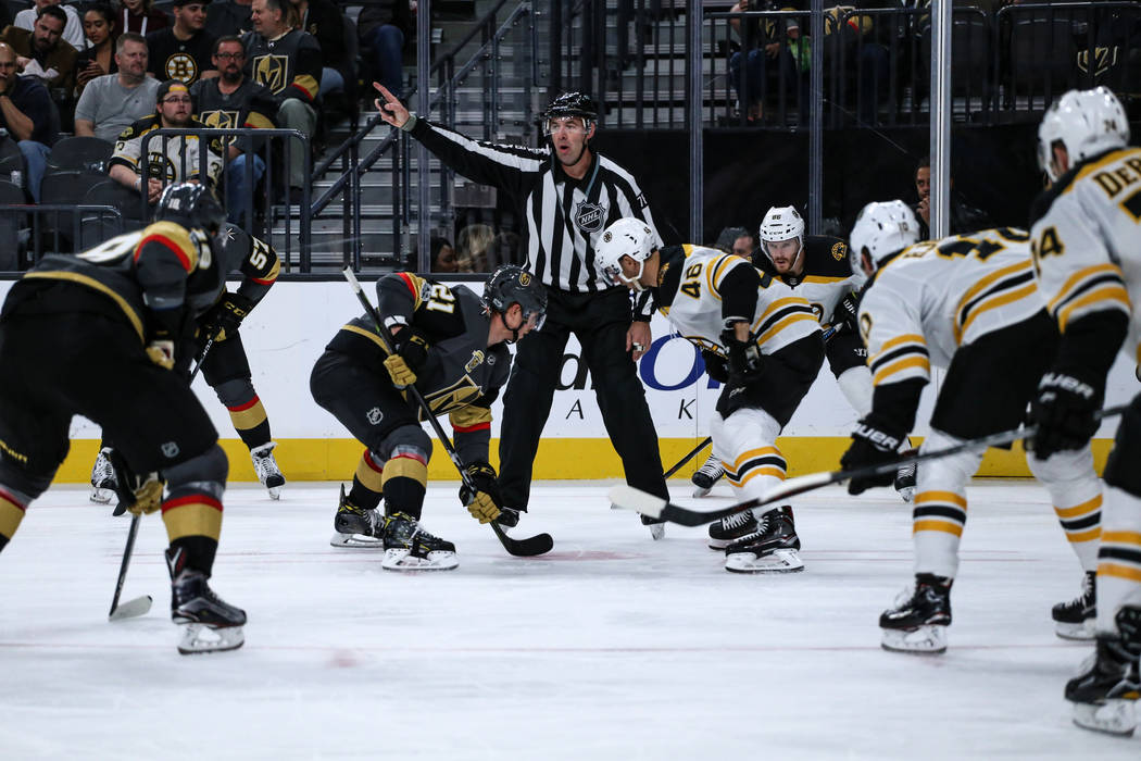 Vegas Golden Knights center Cody Eakin (21), second from left, and Boston Bruins center David Krejci (46), second from right, face off during a puck drop following a penalty in the second period o ...