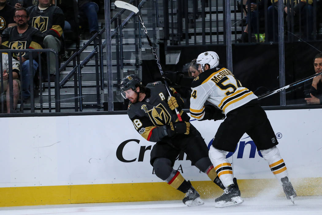 Vegas Golden Knights left wing James Neal (18), left, and Boston Bruins defenseman Adam McQuaid (54), right chase after the puck during the second period of an NHL hockey game at T-Mobile Arena in ...